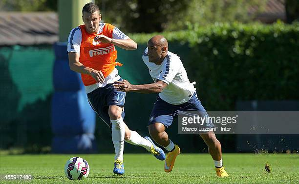 Cicero Moreira Jonathan competes for the ball with Zdravko Kuzmanovic during FC Internazionale training session at the club's training ground on...