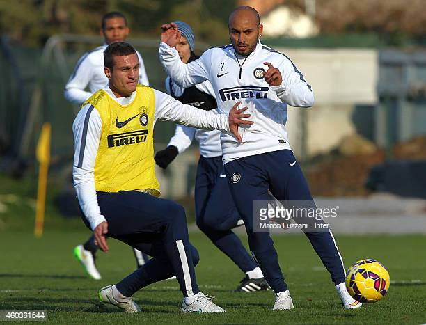 Cicero Moreira Jonathan competes with Nemanja Vidic during FC Internazionale training session at the club's training ground on December 12 2014 in...
