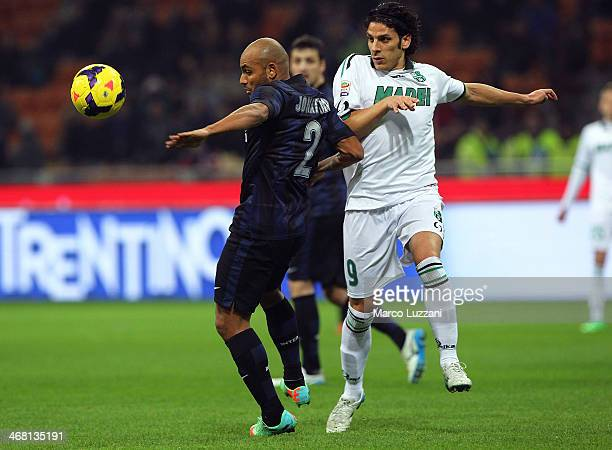 Cicero Moreira Jonathan of FC Internazionale Milano competes for the ball with Sergio Floccari of US Sassuolo Calcio during the Serie A match between...