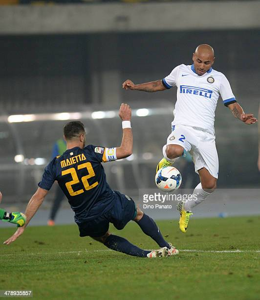 Cicero Moreira Jonathan of Internazionale competes for the ball with Domenico Maietta of Hellas Verona during the Serie A match between Hellas Verona...
