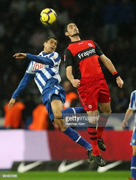 Cicero of Berlin and Nikos Liberopoulos of Frankfurt jump for a header during the Bundesliga match between Hertha BSC Berlin and Eintracht Frankfurt...