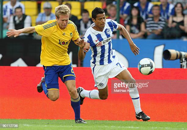 Cicero of Berlin battles for the ball with Anders Randrup of Kopenhagen during the UEFA Europa League qualification match between Hertha BSC Berlin...