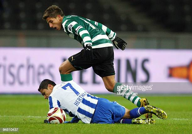 Cicero of Berlin battles for the ball with Daniel Carrico of Lissabon during the UEFA Europa League match between Hertha BSC Berlin and Sporting...