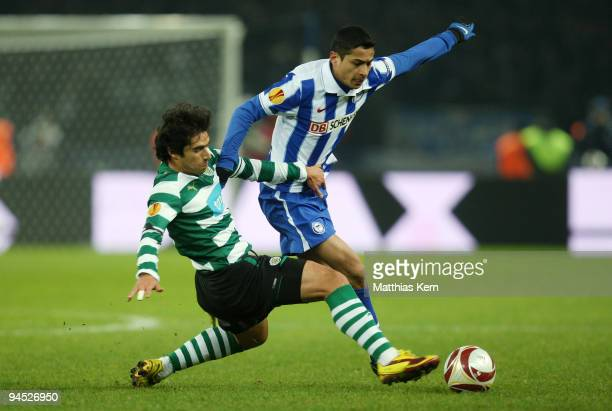 Cicero of Berlin battles for the ball with Leandro Grimi of Lissabon during the UEFA Europa League match between Hertha BSC Berlin and Sporting...