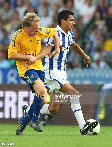 Cicero of Berlin battles for the ball with Michael KrohnDehli of Kopenhagen during the UEFA Europa League qualification match between Hertha BSC...