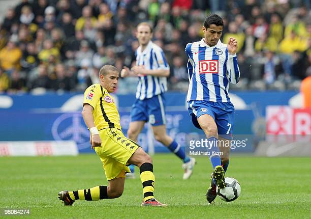 Cicero of Berlin battles for the ball with Mohamed Zidan of Dortmund during the Bundesliga match between Hertha BSC Berlin and Borussia Dortmund at...