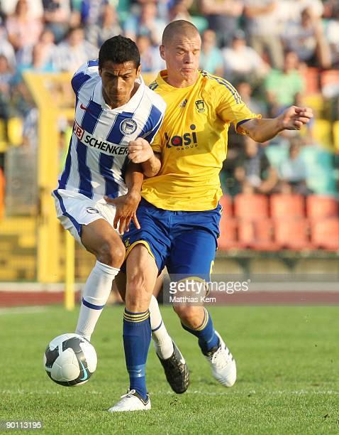 Cicero of Berlin battles for the ball with Samuel Holmen of Kopenhagen during the UEFA Europa League qualification match between Hertha BSC Berlin...
