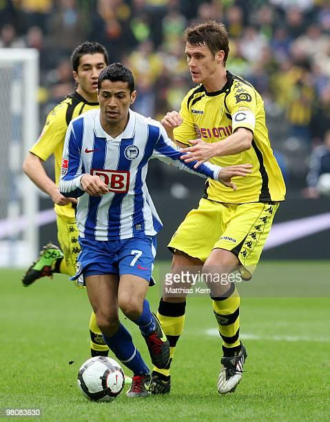Cicero of Berlin battles for the ball with Sebastian Kehl of Dortmund during the Bundesliga match between Hertha BSC Berlin and Borussia Dortmund at...