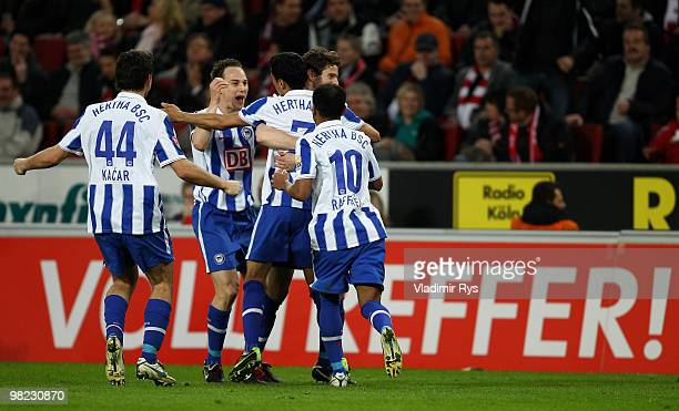 Cicero of Berlin is celebrated by his team mates after scoring his team's third goal during the Bundesliga match between 1 FC Koeln and Hertha BSC...