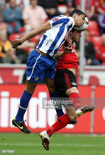 Cicero of Berlin jumps for a header with Gonzalo Castro of Leverkusen during the Bundesliga match between Bayer Leverkusen and Hertha BSC Berlin at...