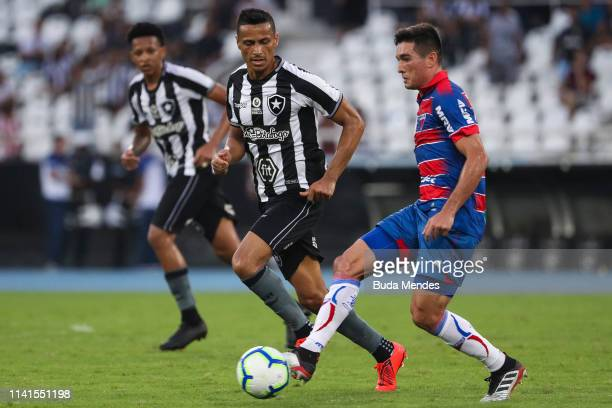Cicero of Botafogo struggles for the ball with Juninho of Fortaleza during a match between Botafogo and Fortaleza as part of Brasileirao Series A...