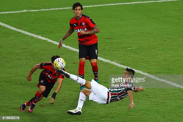 Cicero of Fluminense struggles for the ball with Victor Ramos and Tiago Real of Vitoria during a match between Fluminense and Vitoria as part of...