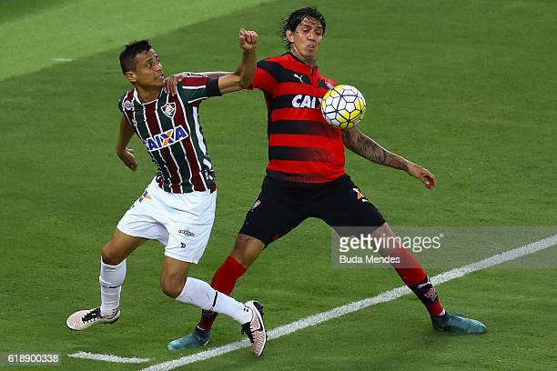 Cicero of Fluminense struggles for the ball with Victor Ramos of Vitoria during a match between Fluminense and Vitoria as part of Brasileirao Series...