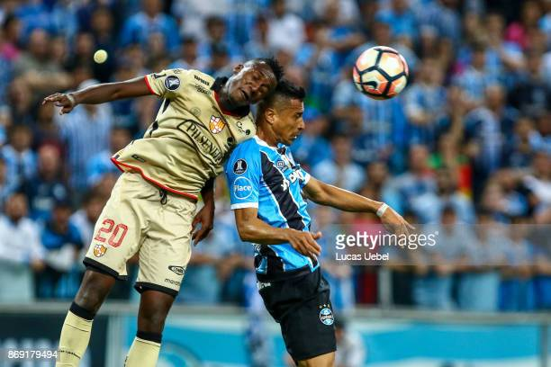 Cicero of Gremio battles for the ball against Eli Esterilla of Barcelona de Guayaquil during Gremio v Barcelona de Guayaquil match part of Copa...