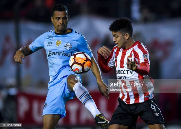 Cicero of Gremio fights for the ball with Lucas Rodriguez of Estudiantes during a round of sixteen first leg match between Estudiantes de La Plata...