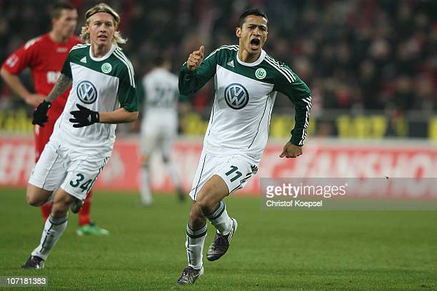 Cicero of Wolfsburg celebrates the first goal during the Bundesliga match between 1 FC Koeln and VfL Wolfsburg at RheinEnergieStadion on November 28...