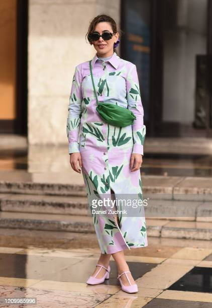 Cici Celia is seen wearing a pink and white floral dress with green bag and pink heels outside the Akris show during Paris Fashion Week AW20 on March...