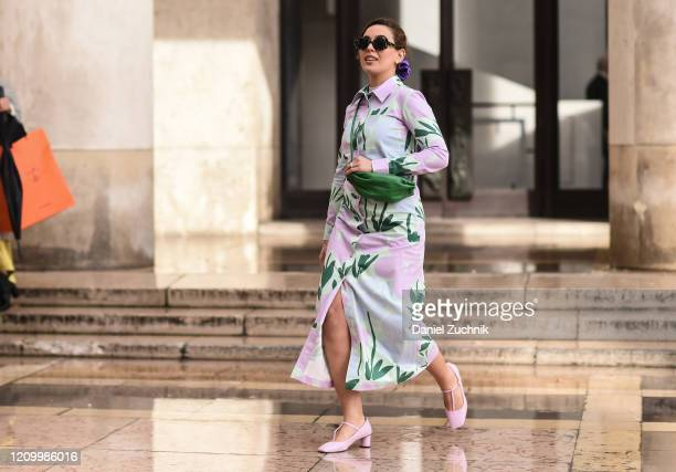 Cici Celia is seen wearing a pink and white floral dress with green bag and pink heels outside the Akris show during Paris Fashion Week: AW20 on...