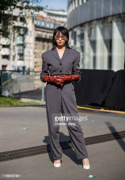 Cici Wang is seen wearing grey overall outside Acne during Paris Fashion Week Haute Couture Fall/Winter 2019/2020 on June 30 2019 in Paris France