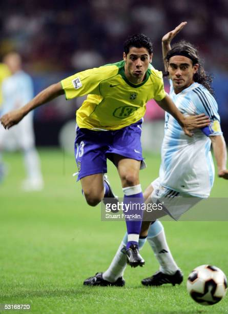 Cicinho of Brazil evades Juan Sorin of Argentina during the FIFA 2005 Confederations Cup Final between Brazil and Argentina at the Waldstadion on...