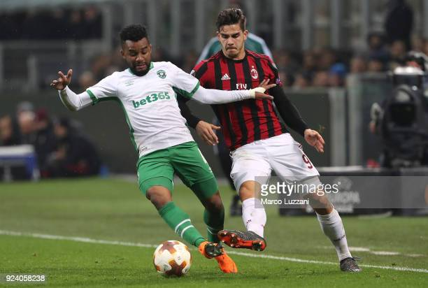Cicinho of Ludogorets Razgrad competes for the ball with Andre Silva of AC Milan during UEFA Europa League Round of 32 match between AC Milan and...