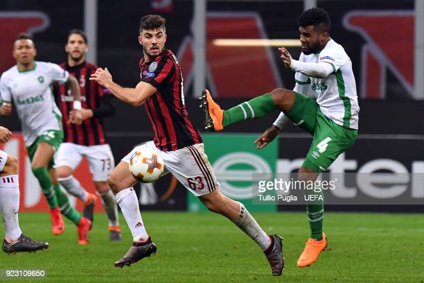 Cicinho of Ludogorets Razgrad kicks the ball as Patrick Cutrone of AC Milan tackles for the ball during UEFA Europa League Round of 32 match between...