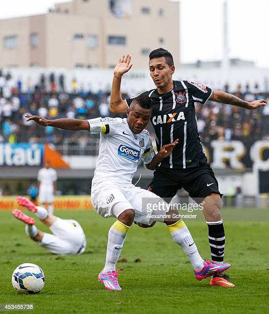 Cicinho of Santos and Guerrero of Corinthians in action during the match between Santos and Corinthians for the Brazilian Series A 2014 at Vila...