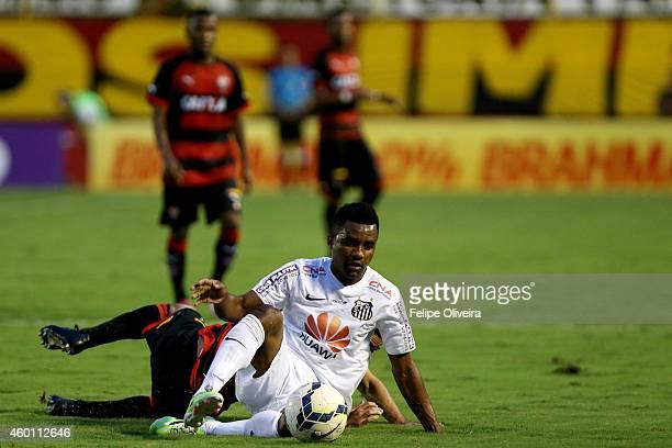 Cicinho of Santos battles for the ball during the match between Vitoria and Santos as part of Brasileirao Series A 2014 at Estadio Manoel Barradas on...