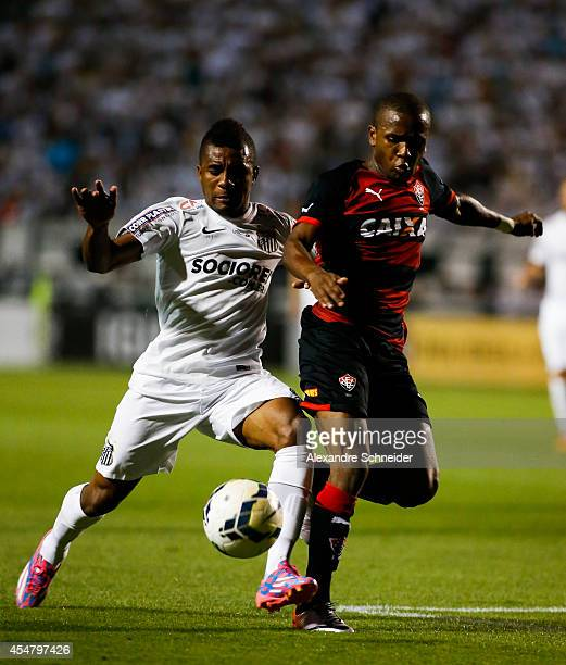 Cicinho of Santos in action during the match between Santos and Vitoria for the Brazilian Series A 2014 at Pacaembu stadium on September 6, 2014 in...