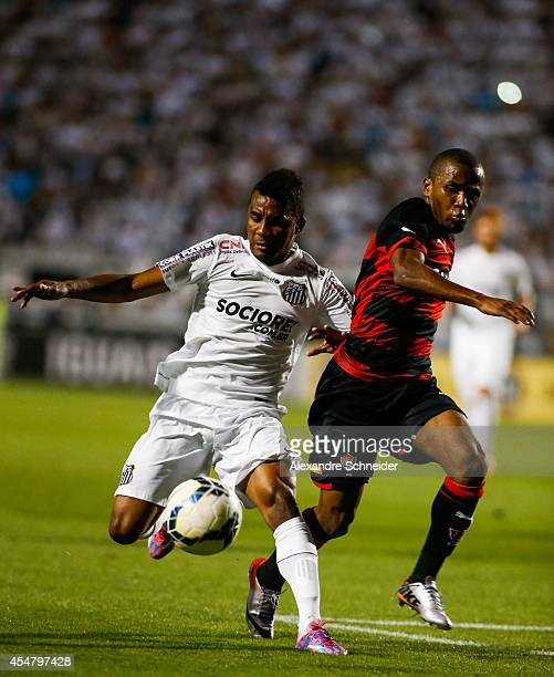 Cicinho of Santos in action during the match between Santos and Vitoria for the Brazilian Series A 2014 at Pacaembu stadium on September 6 2014 in...