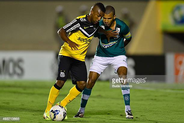 Cicinho of Santos struggles for the ball with Danilo Cezario of Goias during a match between Goias and Santos as part of Brasileirao Series A 2014 at...