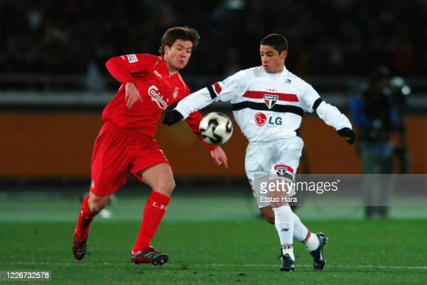 Cicinho of Sao Paulo and Xabi Alonso of Liverpool compete for the ball during the FIFA Club World Championship Toyota Cup final between Sao Paulo and...