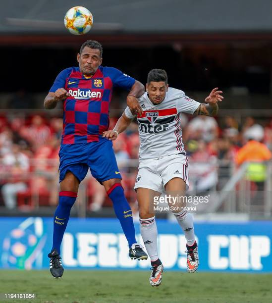Cicinho of Sao Paulo FC vies for the ball with Sony Anderson of Barcelona during a match between Sao Paulo FC and Barcelona for the Legends Cup 2019...