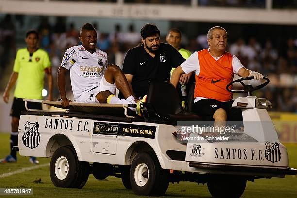 Cicinho os Santos is carried off on a stretcher during the match between Santos and Sport Recife for the Brazilian Series A 2014 at Vila Belmiro...