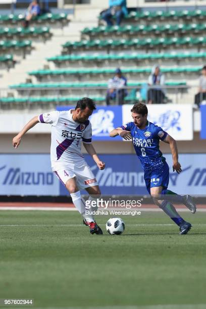 Cicinio of Tokushima Vortis and Marcus Tulio Tanaka of Kyoto Sanga compete for the ball during the JLeague J2 match between Tokushima Vortis and...