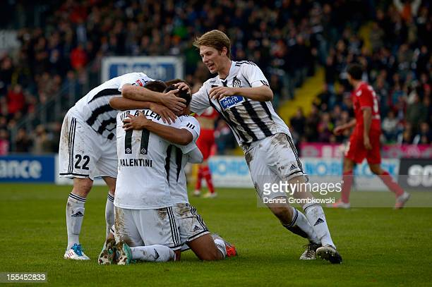 Cidimar da Silva of Aalen celebrates his team's second goal with his teammates during the Second Bundesliga match between VfR Aalen and 1 FC Koeln at...