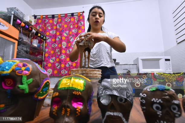 Cielo Jimenez seen manufacturing chocolate skull at chocolate factory on October 23 2019 in Mexico City Mexico Mrs Judith Morales founded 30 years...
