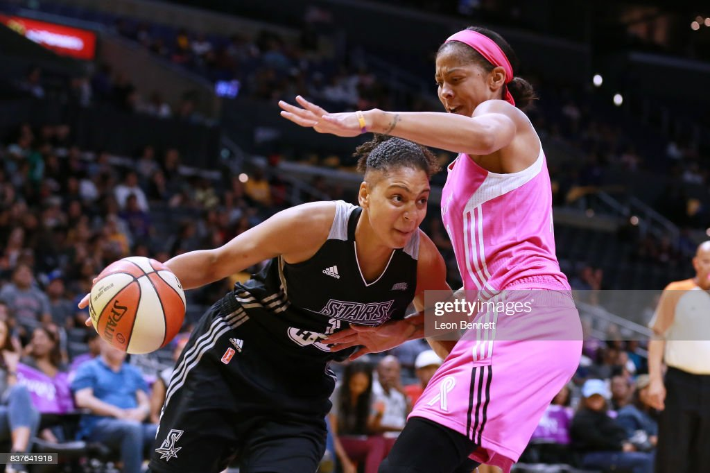 Cierra Burdick #11 of the San Antonio Stars handles the ball against Candace Parker #3 of the Los Angeles Sparks during a WNBA game at Staples Center on August 22, 2017 in Los Angeles, California.