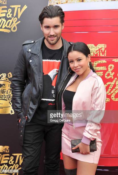 Cierra Ramirez and Jeff Wittek arrive at the 2017 MTV Movie And TV Awards at The Shrine Auditorium on May 7 2017 in Los Angeles California
