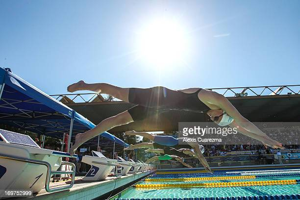 Cierra Runge Jessica Hardy and Dana Collmer dive to begin the Women's 100 meter free style to begin during Day Two of the Santa Clara International...