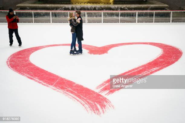 Cierra Sorrells and Jacob Cox embrace after Cox proposed on Valentine's Day at Rockefeller Center Ice Rink February 14 2018 in New York City Sorrells...