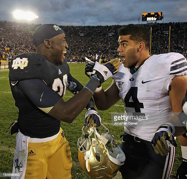 Cierre Wood of the Notre Dame Fighting Irish and Uona Kaveinga of the BYU Cougars share a moment after the game at Notre Dame Stadium on October 20...