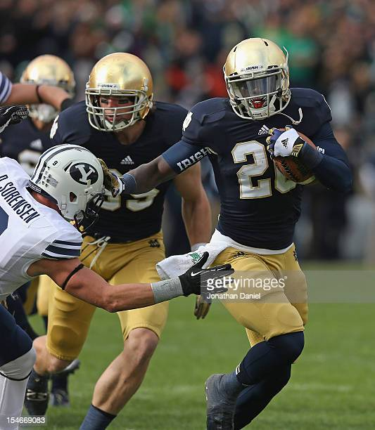 Cierre Wood of the Notre Dame Fighting Irish breaks away from Daniel Sorensen of the BYU Courgars at Notre Dame Stadium on October 20 2012 in South...