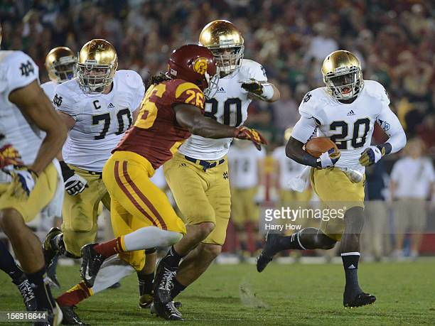 Cierre Wood of the Notre Dame Fighting Irish carries the ball as he gets a block from Tyler Eifert on Josh Shaw of the USC Trojans during a 2213...