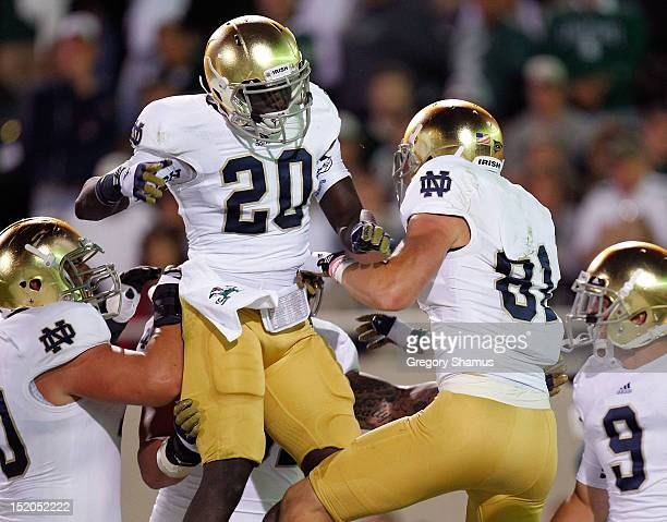 Cierre Wood of the Notre Dame Fighting Irish celebrates with John Goodman after Goodmans first quarter touchdown catch while playing the Michigan...