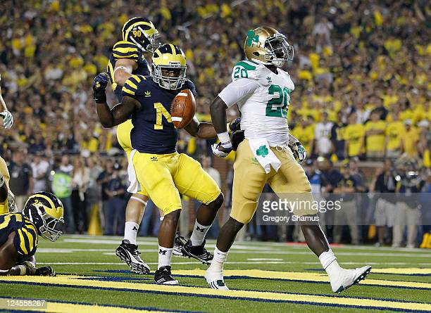 Cierre Wood of the Notre Dame Fighting Irish gets in for a first quarter touchdown in front of Thomas Gordon of the Michigan Wolverines at Michigan...