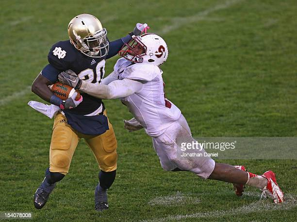 Cierre Wood of the Notre Dame Fighting Irish tries to fight off Jordan Richards of the Standford Cardinal at Notre Dame Stadium on October 13 2012 in...
