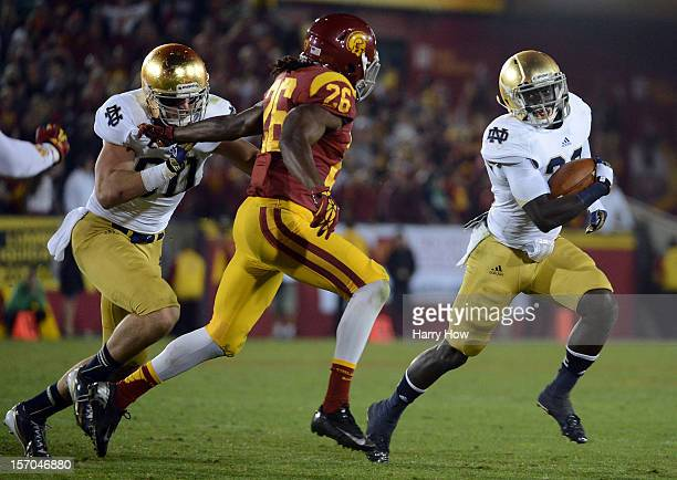 Cierre Wood of the Notre Dame Fighting Irish turns the corner on Josh Shaw of the USC Trojans during a 2213 Irish win at Los Angeles Memorial...