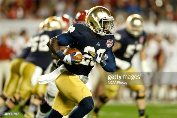 Cierre Wood of the University of Notre Dame rushes up field against the University of Alabama during the Discover BCS National Championship game held...
