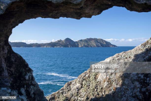 Cies Islands seen from a hole on a rock